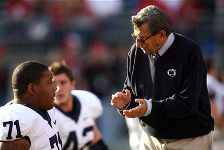 Penn State head coach Joe Paterno talks with Devon Still prior to the start of their NCAA football game in Columbus