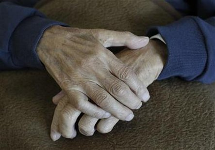 The hands of a pensioner are pictured during an afternoon nap at residential home in Eichenau