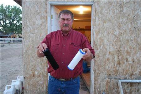 Jeff Locker, a Wyoming farmer, displays water filters from his well
