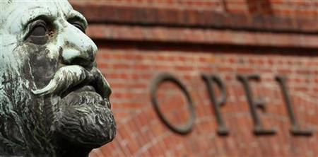 The statue of German car manufacturer Opel founder, Adam Opel is seen in front of the main gate at the headquarters in Ruesselsheim
