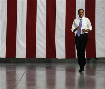 U.S. President Barack Obama walks at battery facility Johnson Controls, Inc., in Holland, Michigan