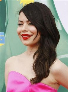 Actress Miranda Cosgrove poses at the 2011 Nickelodeon Kids Choice Awards in Los Angeles