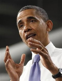U.S. President Barack Obama speaks after he tours battery facility Johnson Controls, Inc., in Holland, Michigan