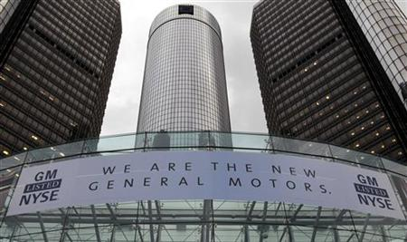 A banner hangs on the front of the General Motors Co world headquarters announcing GM's return to NYSE in Detroit