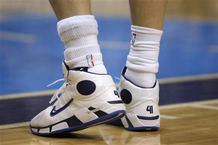 A brace is seen on Dallas Mavericks Nowitzki's ankle during second half NBA action against the Warriors in Dallas