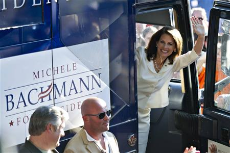 Republican presidential candidate and Minnesota Congresswoman Bachmann waves after her victory in the Iowa straw poll in Ames