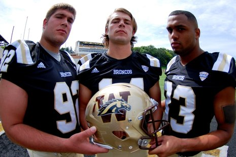 Drew Nowak, Alex Carder and Jordan White display the new WMU football helmet.