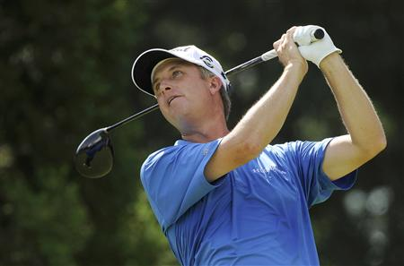 David Toms of the U.S. tees off on the third hole during the first round of the 93rd PGA Championship golf tournament at the Atlanta Athleti