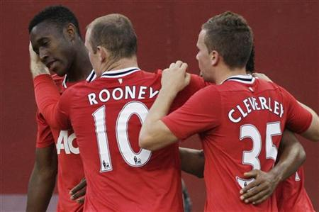 Manchester United's Nani celebrates his goal against Barcelona with teammates Danny Welbeck, Wayne Rooney and Tom Cleverley during their 201