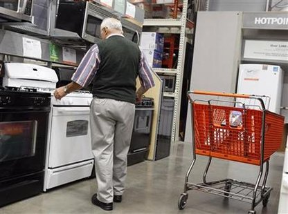 A man shops for an oven at a Home Depot store in New York