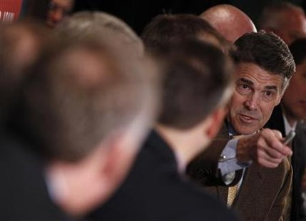 Republican presidential candidate Texas Governor Rick Perry answers a question during a roundtable meeting with business leaders during a ca