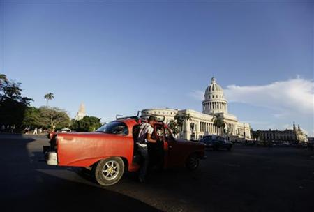 A man boards a private-licensed taxi near Havana's Capitol building