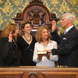 State Rep. Dave Agema (R-Grandville) is sworn in by Michigan Supreme Court Justice Mary Beth Kelly (R) on Jan. 12, 2011, with Agema's wife and daughter looking on. (photo courtesy Michigan House Republicans)