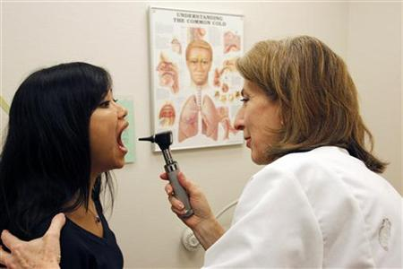 A patient is seen by a doctor at a medical clinic in Silver Spring, Maryland December 3, 2009.