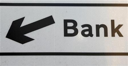 Directions to the Bank district are seen on a sign in the City of London