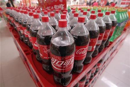 Bottles of Coca-Cola are seen on sale at a supermarket in Xiangfan