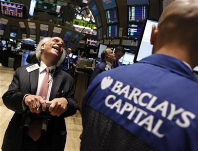 Trader Peter Tuchman shares a laugh with a specialist trader from Barclays Capital on the floor of the New York Stock Exchange
