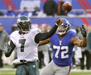 Philadelphia Eagles Vick passes before New York Giants Umenyiora reaches him in East Rutherford