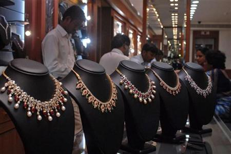 Salesmen at jewellery shop attend to their customers in Hyderabad