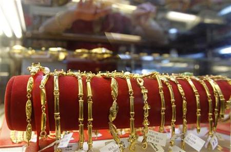 Gold products are displayed for sale at a gold shop in Hanoi