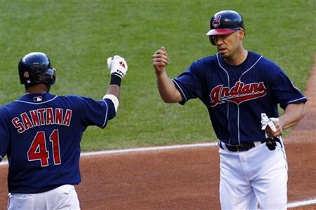 Cleveland Indians Hafner is greeted by Santana after scoring on an Toronto Blue Jays error during their MLB American League baseball game in