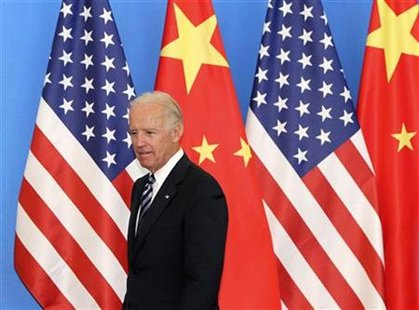 U.S. Vice-President Biden arrives with his Chinese counterpart Xi at a China-US Business Dialogue in the Beijing Hotel in Beijing