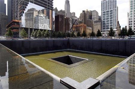 A general view shows the south pool waterfall as work continues on the National September 11 Memorial and Museum at the World Trade Center s