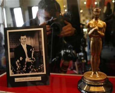 "A photographer takes a picture of the 1934 Oscar awarded to Clark Gable for ""It Happened One Night"" at the ""Meet the Oscars, Chicago"" event"