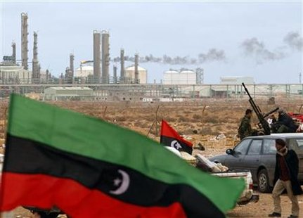 The Kingdom of Libya flag placed in front of a refinery in Ras Lanuf