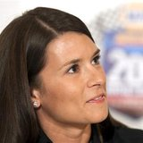 Race car driver Danica Patrick smiles during a news conference in preparation for the NAPA Auto Parts 200 Nationwide Series NASCAR race in M