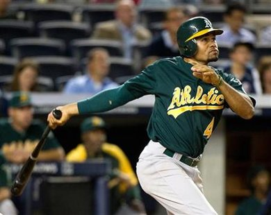 Oakland Athletics Coco Crisp follows through as he hits three-run home run to beat New York Yankees in New York