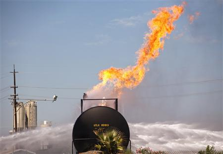 A rail tank car filled with propane continues to burn in Lincoln, California