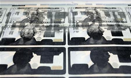 Partially printed new US$20 bills at the Bureau of Engraving and Printing in Washington
