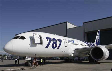 The first Boeing 787 Dreamliner to be delivered to launch customer ANA leaves the paint hangar at Boeing's Everett factory
