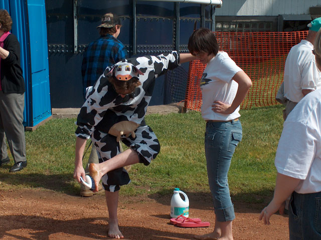 Lee Peek and Nikki Montgomery walk through cow pies for St Jude at the Marathon County June Dairy Breakfast 2005