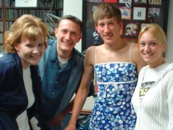 Lee Peek, Kristen Murphy and Nikki Montgomery made this guy wear a dress and drive a scooter all over central WI to win tickets to see Tim McGraw in 2004