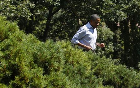 President Obama walks to speak about Hurricane Irene from Martha's Vineyard