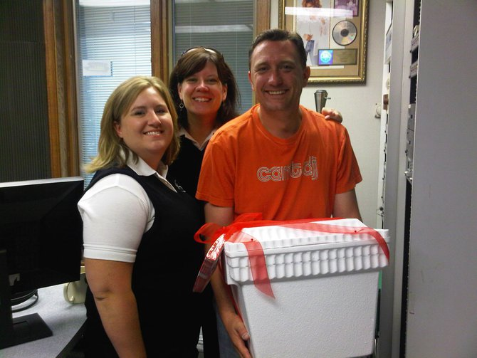 Lee Peek with the ladies from Trigs. They brought him a goodbye/thank you gift on his last day 8/26/11