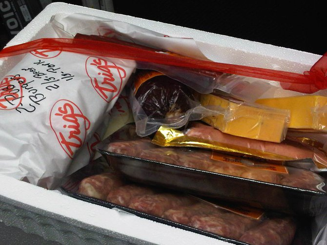 The gift basket from Trig's is filled with all of Lee's favorite things...MEAT, MEAT and More MEAT...oh and some cheese. 8/26/11