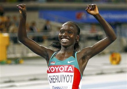 Vivian Cheruiyot of Kenya celebrates winning the women's 10,000 metres final at the IAAF World Championships in Daegu