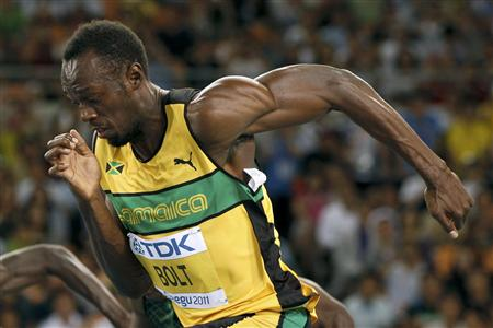 Usain Bolt of Jamaica sprints out of the starting blocks at the start of his men's 100 metres heats at the IAAF World Championships in Daegu