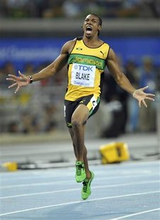 Yohan Blake of Jamaica celebrates winning the men's 100 metres final at the IAAF World Championships in Daegu