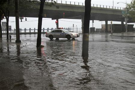 A police car sits surrounded by water in lower Manahattan as Hurricane Irene closes in on the New York City