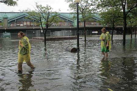 People walk through flooded streets after the pass of Hurricane Irene at Hoboken