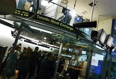 People attend a market open ceremony for Toronto Stock Exchange at the TSX Broadcast Centre in Toronto