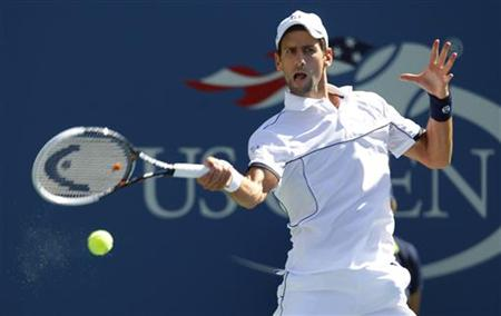 Novak Djokovic of Serbia hits a return to Conor Niland of Ireland during their match at the U.S. Open tennis tournament in New York