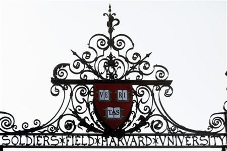 Harvard's seal sits atop a gate to the athletic fields at Harvard University in Cambridge