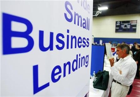 Current and prospective small business owners talk to vendors with information about state, federal, and private funding resources at a Smal