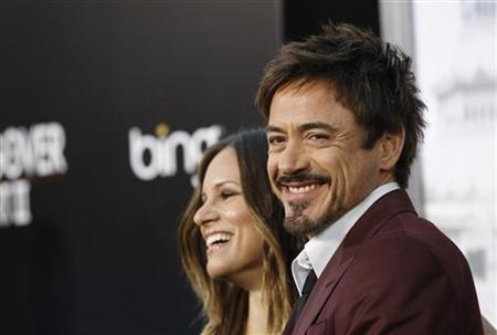 "Downey Jr. and his wife Susan pose at the premiere of ""The Hangover Part II"" at Grauman's Chinese theatre in Hollywood"