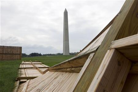 A fallen wooden state park fences is seen on the ground near the Washington Monument